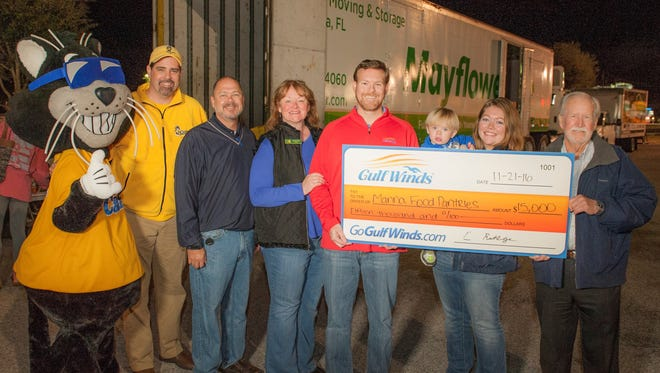 Gulf Winds Federal Credit Union made a $15,000 donation to MANNA Food Pantries for its annual Fill the Mayflower food drive.