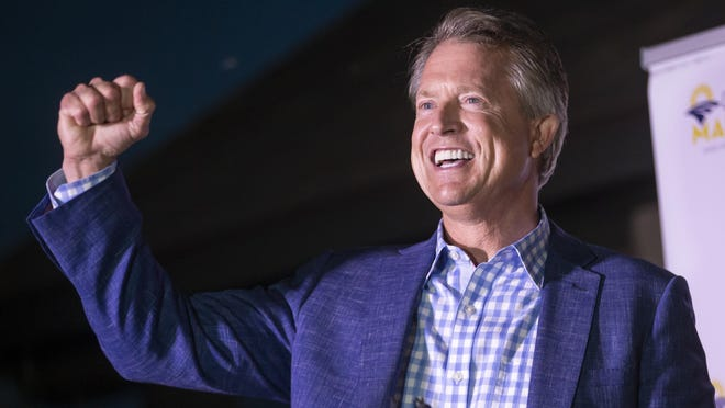 Roger Marshall pumps his fist after speaking to supporters near Pawnee Rock, Kan., Tuesday, Aug. 4, 2020, after defeating Kris Kobach in the Republican primary for U.S. Senate.