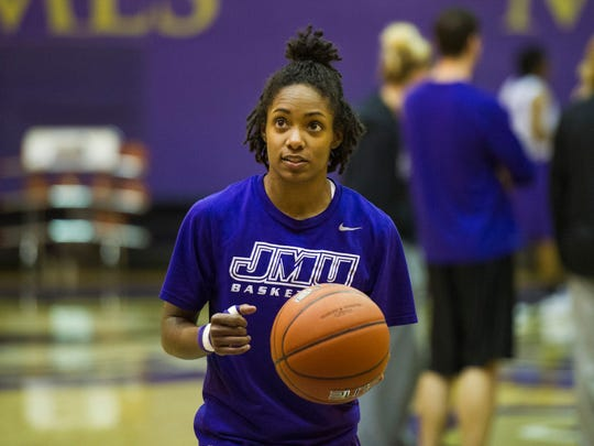 Angela Mickens, a point guard for James Madison University's women's basketball team, gets ready to take a free throw during practice in Harrisonburg on Wednesday.