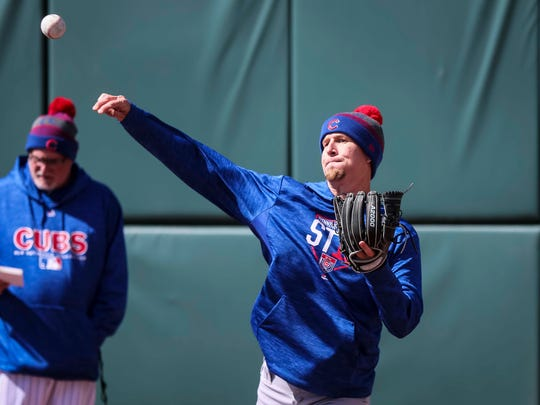 Iowa Cubs' pitcher Alec Mills works out during media day Wednesday, April 4, 2018, at Principal Park before their season opener Thursday.