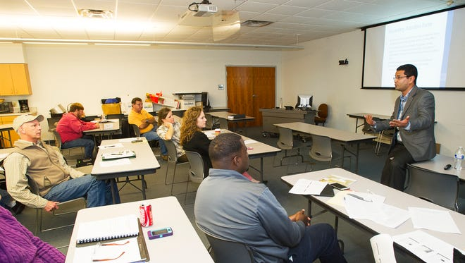 LSU AgCenter extension agents listen as AgCenter food safety specialist Achyut Adhikari, right, talks about forthcoming regulations that are part of the Food Safety Modernization Act during a training session at the Dean Lee Research and Extension Center in Alexandria.