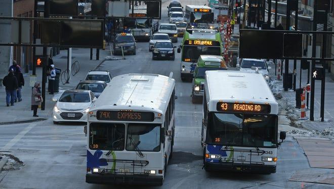 Metro buses move through Downtown.
