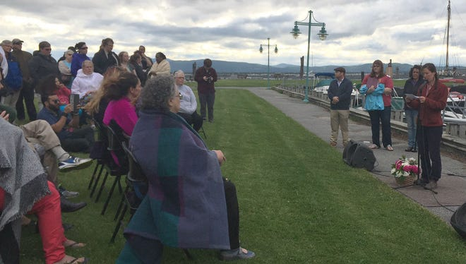 Right, Julia Berberan of the Pride Center of Vermont speaks to a crowd gathered at Perkins Pier during a memorial service for homicide victim Amos Beede.