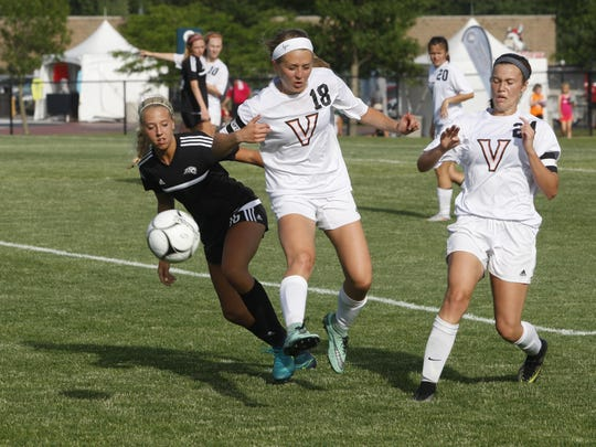 Ankeny Centennial's Allie Wyckoff battles for the ball with Valley's Jadyn Loecke (No. 18) during the Class 3A semifinals of the girls' state soccer tournament on Friday at Cownie Soccer Park. The Jaguars lost, 1-0.