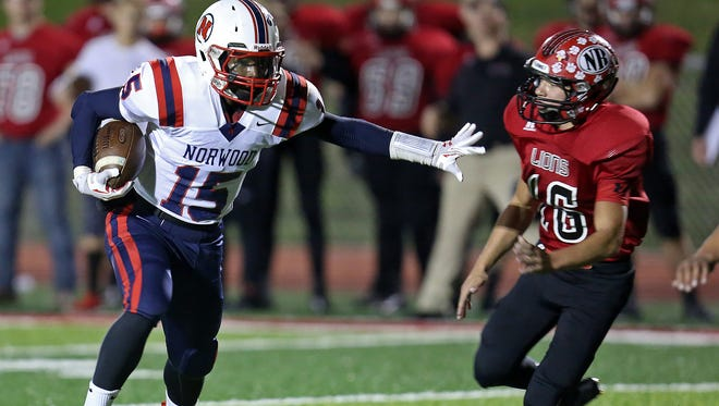 Norwood WR Jihad Key attempts to get past New Richmond DB TJ Gelter after a catch in the first half at New Richmond High School.