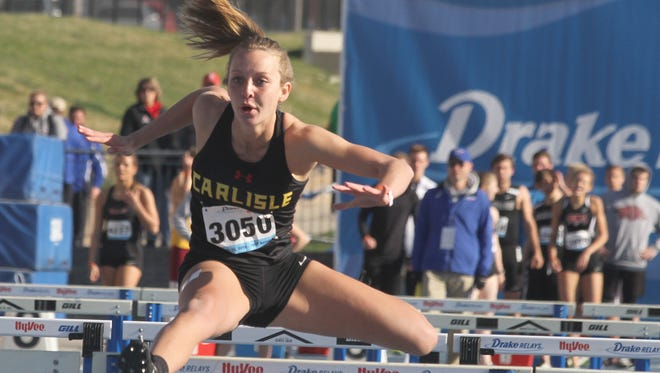 Carlisle senior Aricka Lambson competes in a 4x100-meter shuttle hurdle prelim at the Drake Relays on April 28.