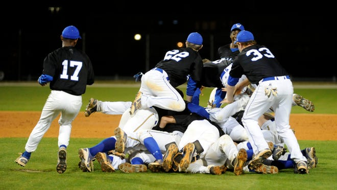 The Washington High Wildcats celebrate winning the 2013 Tate Aggie Classic in a game played at Blue Wahoos stadium. The Wildcats knocked off Edmond North (Okla.) in the championship game that season.