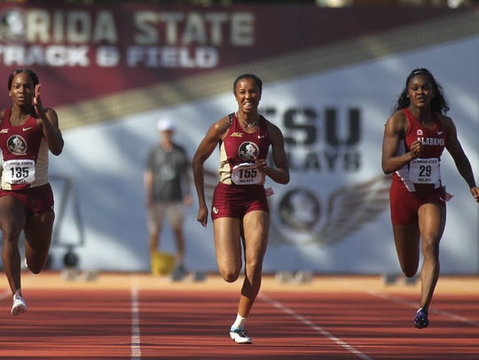 FSU's Alina Stewart (middle) races to a 100-meter dash win at the 2017 FSU Relays.