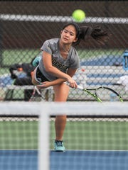Jacqueline Olivia serves a ball during practice at the Anderson University Sports Complex tennis courts.