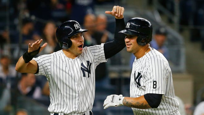 Gary Sanchez of the Yankees celebrates his first inning two-run home run against the Boston Red Sox with teammate Jacoby Ellsbury at Yankee Stadium on Sept. 27, 2016. Sanchez is one of the finalists for the American League Jackie Robinson Rookie of the Year award.