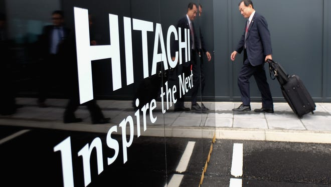 Hitachi has agreed to a $19 million settlement of U.S. charges the Japanese multinational improperly recorded more than $10 million in payments to a front for South Africa's ruling party in connection with successful efforts to win power plant contracts.