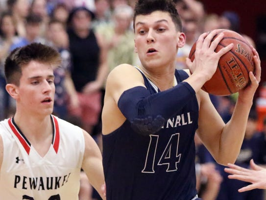Whitnall's Tyler Herro drives around Pewaukee's Josh