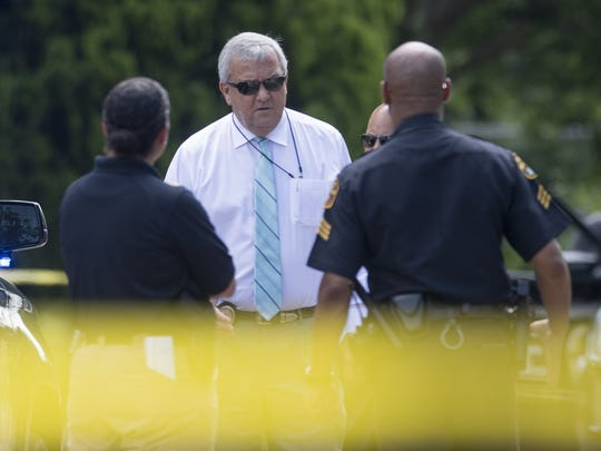 Public Safety Director Chris Murphy on the scene as Montgomery Police investigate a fatal shooting on Garden St. in Montgomery on June 28, 2017.