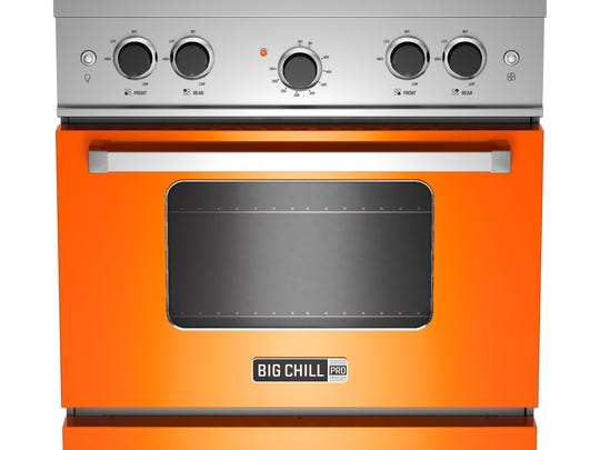 This photo provided by Big Chill shows a Pro range in orange. With strong color trending in kitchens, Big Chill?s vibrant hues in fridges, ovens and range hoods hit the style mark.  As a pop of color in an otherwise low key kitchen, or as part of an overall exuberant space, appliances like these, particularly with some retro details, stand out from the standard stainless offerings. (AP Photo/Big Chill)