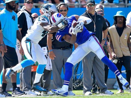 Captain Munnerlyn of the Carolina Panthers tackles Jordan Matthews of the Buffalo Bills during their game at Bank of America Stadium on Sunday.