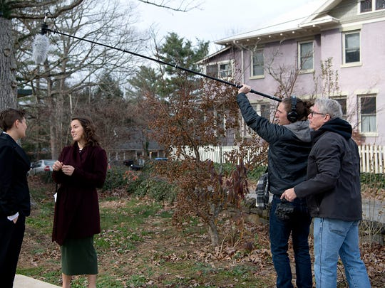 """Professional actors Missy Bell, left, and Brooke German, middle right, act out a scene while film instructor Brad Hoover, far right, assists student Ezekiel MacMillam with the proper distance to hold a boom mic Saturday Dec. 3, 2016 on Kenilworth Road during the filming of """"House of KaBam,"""" a film currently underway by filmmaking 101 students with the Asheville School of Film."""