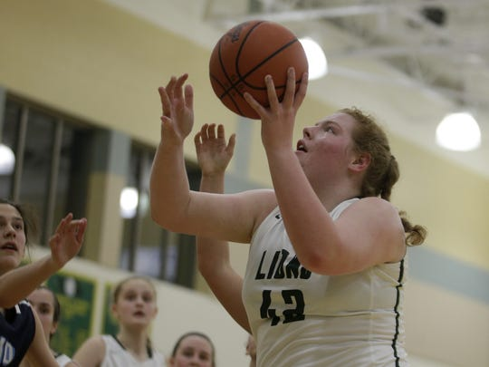Ursuline's Emma  Shaffer shoots the ball.
