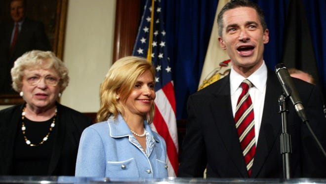 New Jersey Gov. Jim McGreevey. right, is shown with his wife, Dina Matos McGreevey, and mother, Ronnie, after a Statehouse press conference announcing that he is gay and will be resigning on Nov. 15, 2004, because of an extramarital affair.