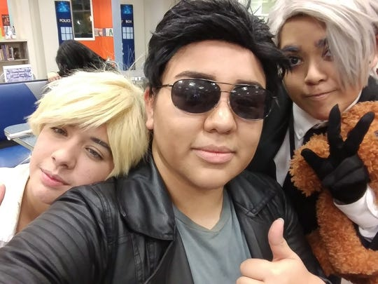 Sierra Dominguez, center, and friends dress in casual cosplay for a manga mixer. The upcoming mixer highlights Valentine's Day.