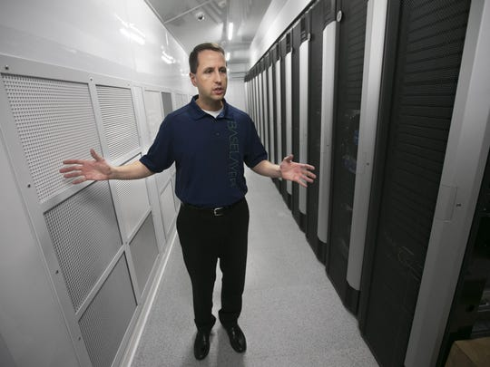 Andreas Zoll, VP of Engineering and Product Development for Baselayer, speaks by a row of servers, at a data substation for Baselayer, a tech company at SRPÕs Corbell Substation in Gilbert on August 26, 2015.