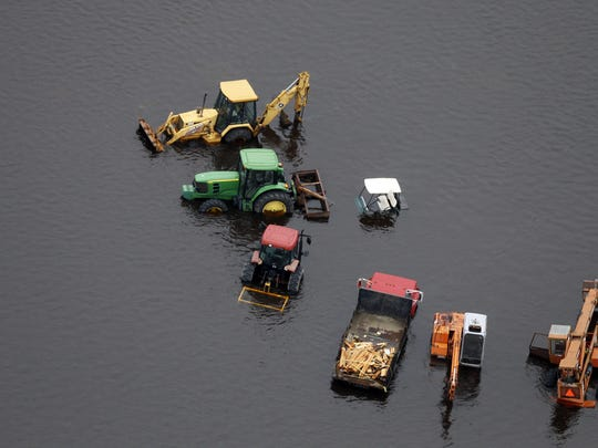 In this Sept. 16 photo, farm equipment is surrounded by floodwaters in the aftermath of Hurricane Florence near Trenton, N.C.