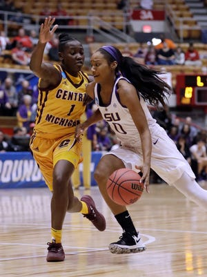 LSU's guard Chloe Jackson (0) drives against Central Michigan's Micaela Kelly (1) during the first half of CMU's 78-69 win in the first round of the the NCAA women's tournament, Saturday, March 17, 2018, in Columbus, Ohio.
