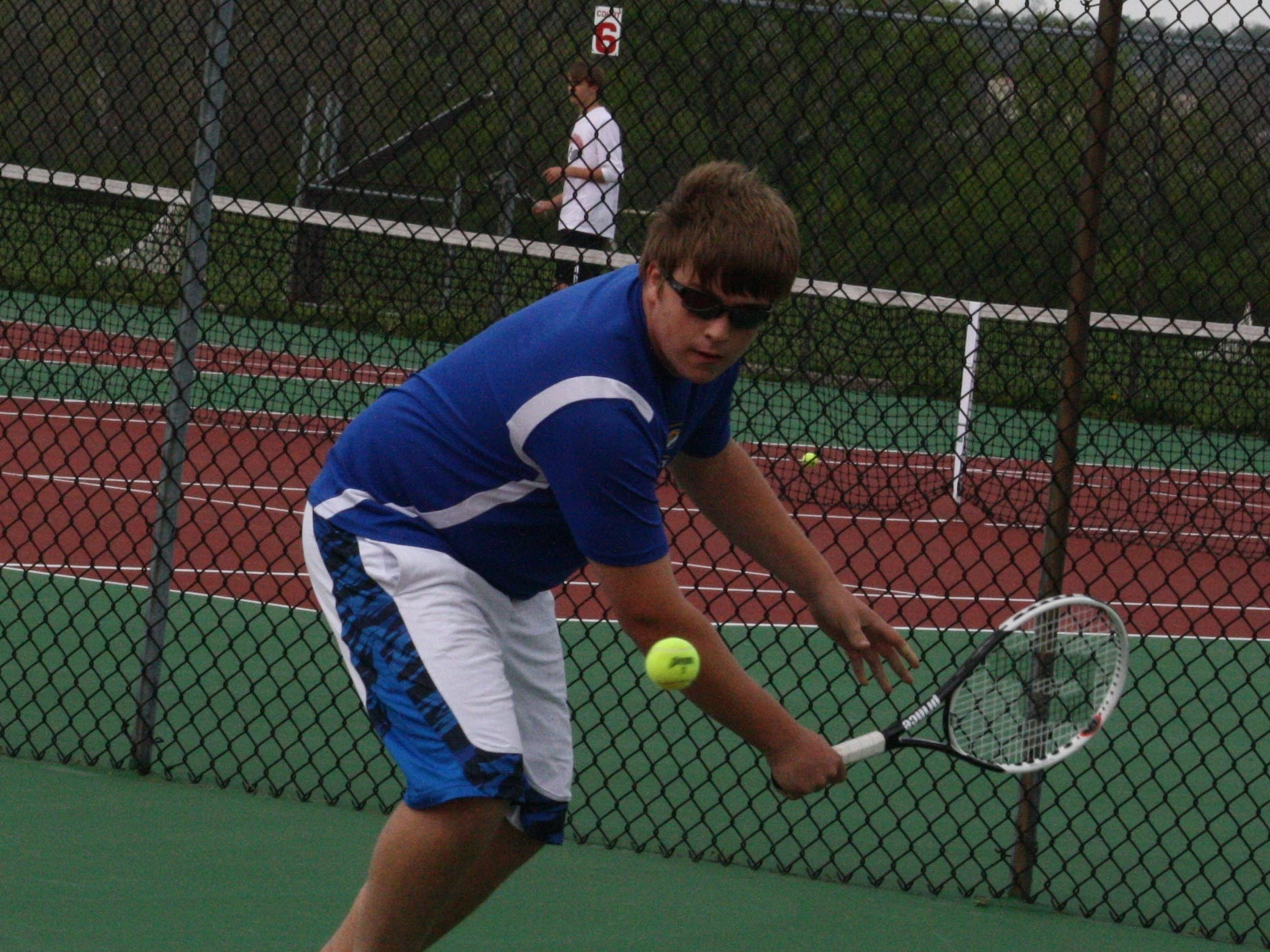 Madeira's Travis Freytag hits a return during his opening round match of the GCTCA Coaches Classic last season.