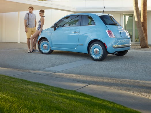 A postmodern car, the Fiat 500 1957 Edition, with a postmodern house