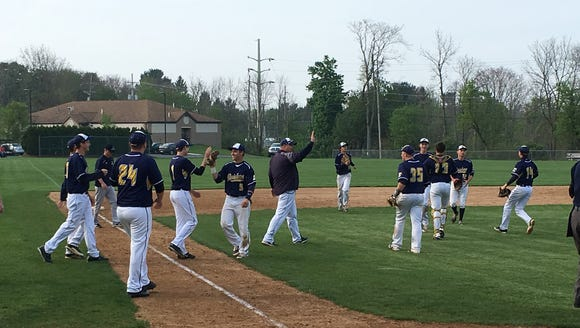 The Elco baseball team celebrates its 1-0 win at Lebanon