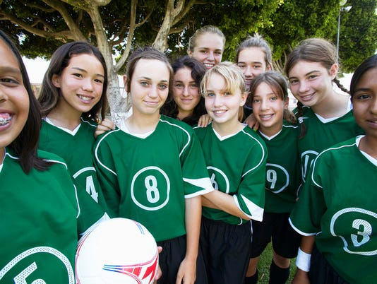 Girls football team, smiling