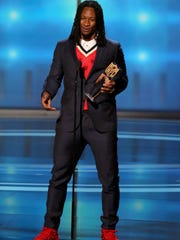 The Rams' Todd Gurley accepts the award for the Associated Press 2017 NFL Offensive Player of the Year at the seventh annual NFL Honors at the Cyrus Northrop Memorial Auditorium on Saturday in Minneapolis.