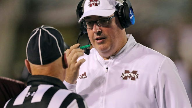 Mississippi State head coach Joe Moorhead talks to an official during the second half of their NCAA college football game against Louisiana-Lafayette on Saturday, Sept. 15, 2018, in Starkville, Miss. Mississippi State won 56-10. (AP Photo/Jim Lytle)