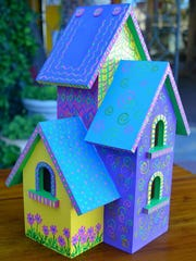 Birdhouses painted in folk art style by regional artists, including Sally Quillin's creations, shown here, will be exhibited at  Quillin-Stephens Gallery during the Downtown Ramble. Several birdhouses will be up for bid to benefit  ACTion Programs for Animals.