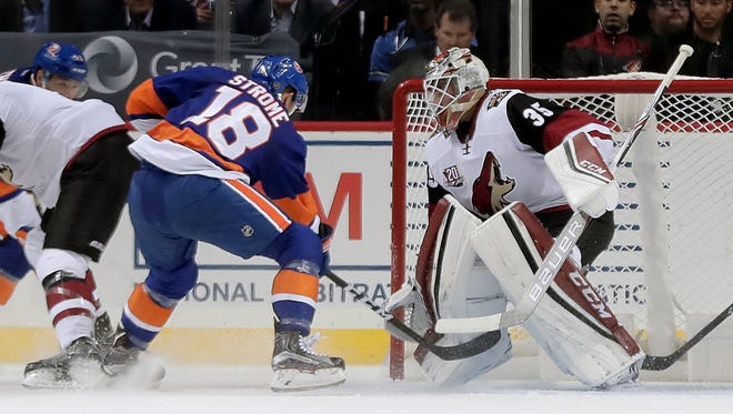 Islanders right wing Ryan Strome (18) scores a goal against Coyotes goalie Louis Domingue (35) during the first period, Friday, Oct. 21, 2016, in New York.