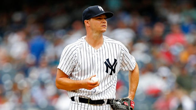 Aug 1, 2018; Bronx, NY, USA;  New York Yankees starting pitcher Sonny Gray (55) pauses before pitching in the first inning against the Baltimore Orioles at Yankee Stadium.