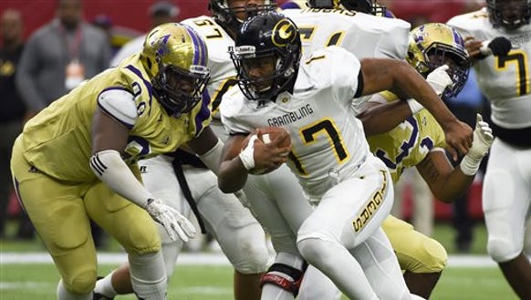 Grambling State quarterback Johnathan Williams (17) scampers past Alcorn State defensive lineman Deion McNair (99) for a touchdown in the second quarter of the Southwestern Athletic Conference championship college football game, Saturday, Dec. 5, 2015, in Houston. (AP Photo/Eric Christian Smith)