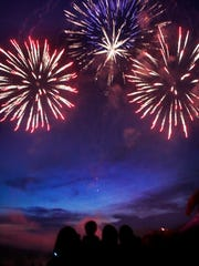 Fireworks burst in the sky at the end of the Symphony on the Prairie's Star Spangled Symphony concert in 2011.