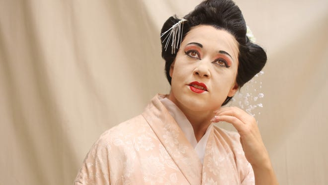 """With a wig, makeup and three costume changes, Maria Luigia Borsi becomes the geisha Cio-Cio San in """"Madame Butterfly."""""""