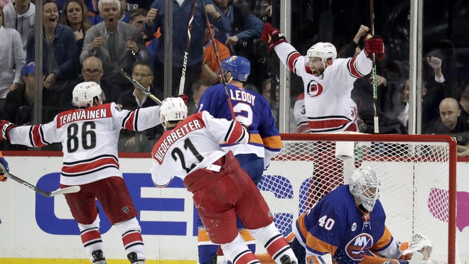 Carolina Hurricanes center Jordan Staal, top right, reacts after scoring an overtime goal on New York Islanders goaltender Robin Lehner (40), during Game 1. The Hurricanes won 1-0.