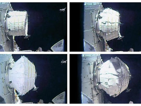 This combination of images provided by NASA shows the inflation of a new experimental room at the International Space Station on Saturday, May 28, 2016.