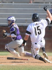 Abilene High's J.D. Dugger (15) scores on Doak Holloway's ground ball to short in the second inning as Keller Timber Creek catcher Nic Thompson fields the throw home. Thompson never moved to make a tag on the play as the Eagles took a 2-1 lead. Abilene High won the game 4-1.