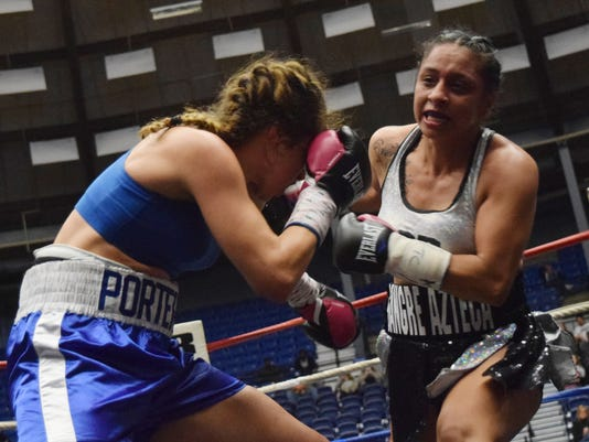 """""""Lovely"""" Lisa Porter and Selina """"Aztec Queen"""" Barrios face off in a 10-round boxing match for the North American Boxing Federation (NABF) lightweight title at the Rapides Parish Coliseum Friday, Dec. 29, 2017. Barrios won the match. Barrios has four ringside world amateur titles and various national championships. Porter won three Police Athletics/Activities League (PAL) national championships, U.S. Golden Gloves and was a U.S. Nationals silver medalist."""