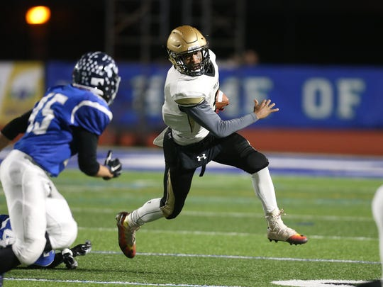 Athena's Tavon Granison looks to turn the corner against Whitesboro in the Class A state semifinal game.