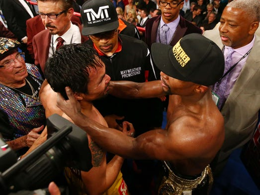 Floyd Mayweather and Manny Pacquiao embrace after their