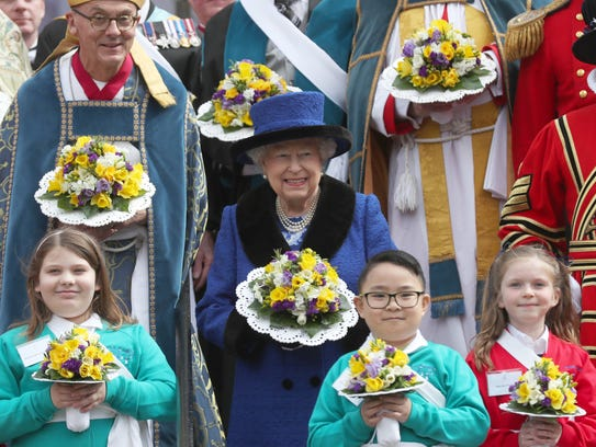 Queen Elizabeth II poses at the annual Royal Maundy