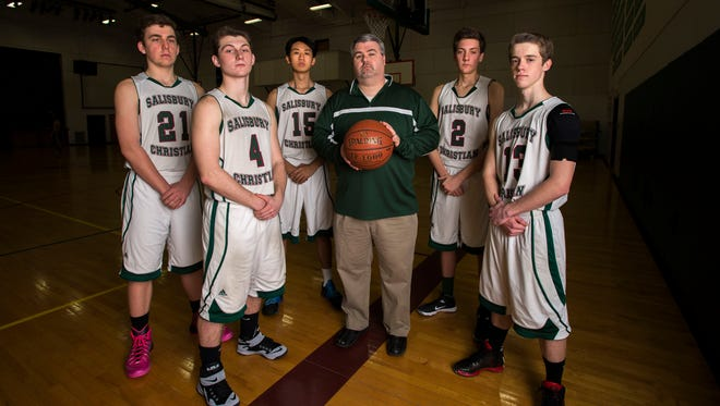 From left are Salisbury Christian basketball's Michael Vogel, Joey Choquette, Danny Kang, Coach Dave Etling, Caleb Anderson, and Josh Smith.