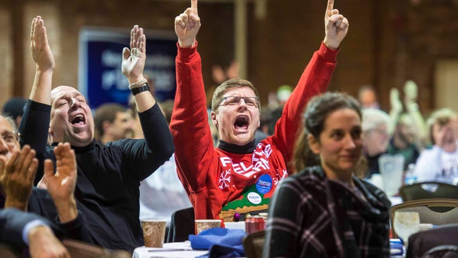 David Vogt of Milford N.H., right, cheers as Bernie Sanders supporters gather to watch the Democratic presidential candidate debate in Manchester N.H. on Saturday, December 19, 2015.
