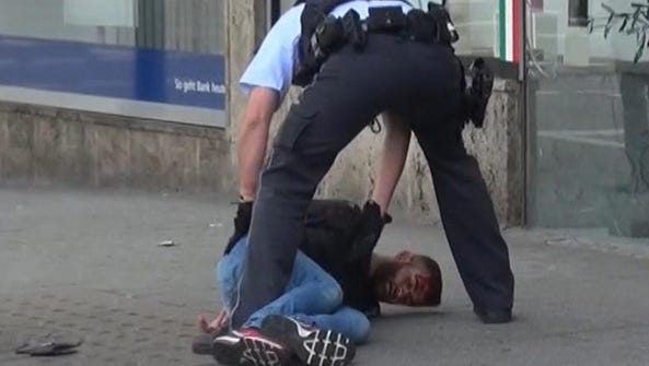 In this picture taken from a video, police arrest a