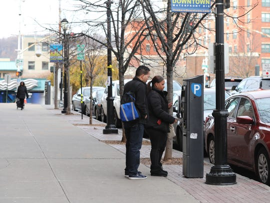 Christian Olivo and Dira Ramirez use a Parkeon munimeter
