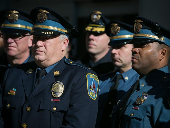 Members of the Capital Police stand nearby as acting